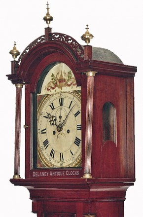A cross banded cherry case New England grandfather clock. Delaney Clocks.